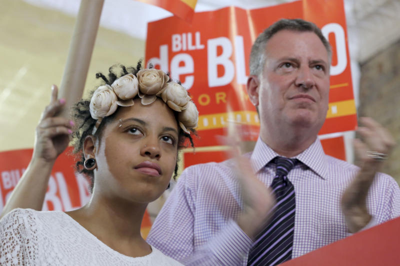 Democratic mayoral hopeful Bill de Blasio, right, is joined by his daughter Chiara, during a campaign rally in the Brooklyn borough of New York, Saturday, Sept. 7, 2013. The Democratic primary election is Tuesday, Sept. 10. (AP Photo/Mary Altaffer)