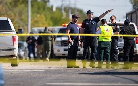 Law enforcement officials work the scene of a fatal shooting at the First Baptist Church in Sutherland Springs, Texas - Credit: Nick Wagner/Austin American-Statesman via AP
