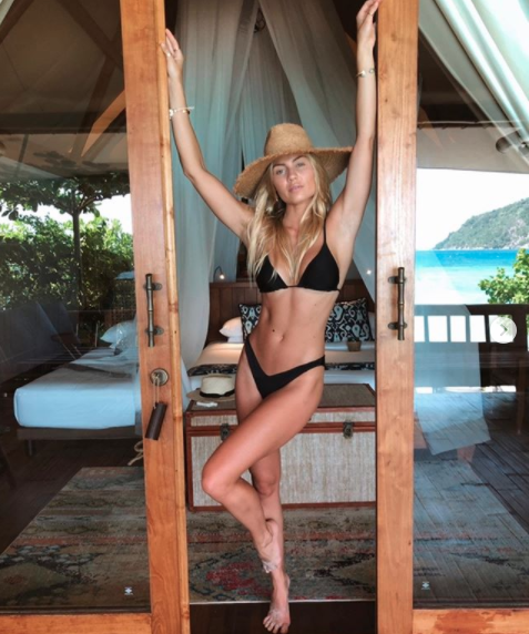 Elyse Knowles in a black bikini
