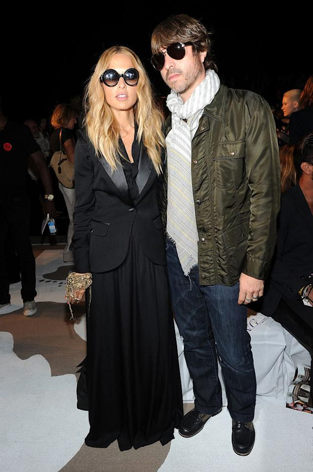 "Were new parents Rachel Zoe and Rodger Berman hiding bags under their eyes from late nights with their 6-year-old son Skyler? The couple both wore shades as they attended the Diane Von Furstenberg show together on Sunday. Jason Kempin/<a href=""http://www.gettyimages.com/"" target=""new"">GettyImages.com</a> - September 11, 2011"