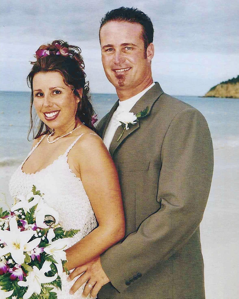 Cassondra Reynolds and her late husband, John, on their wedding day. John drank one energy drink a day before work.