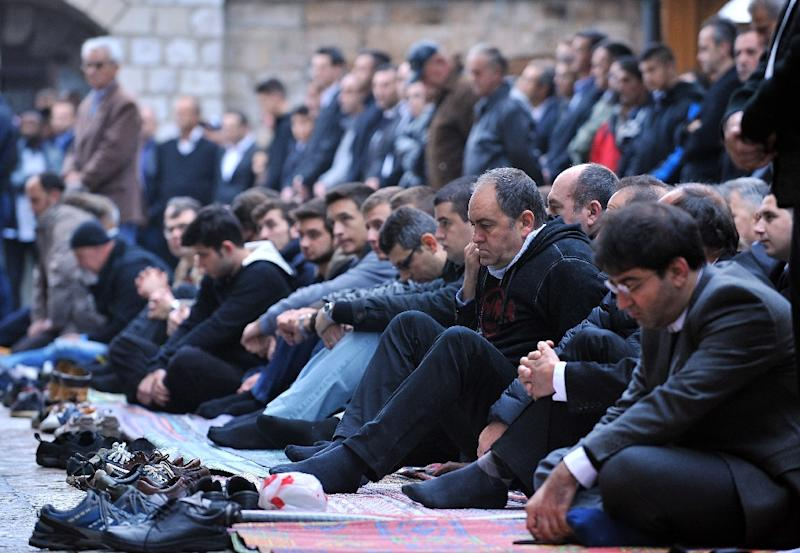 Muslims pray in front of the Gazi-Husref Bey's mosque in Sarajevo, Bosnia, a country home to 3.8 million people, 40 percent of whom are Muslim