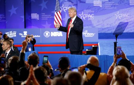 U.S. President Donald Trump gives his supporters a thumbs up he spoke at the Conservative Political Action Conference, or CPAC, in Oxon Hill in Maryland, U.S., February 24, 2017.  REUTERS/Kevin Lamarque