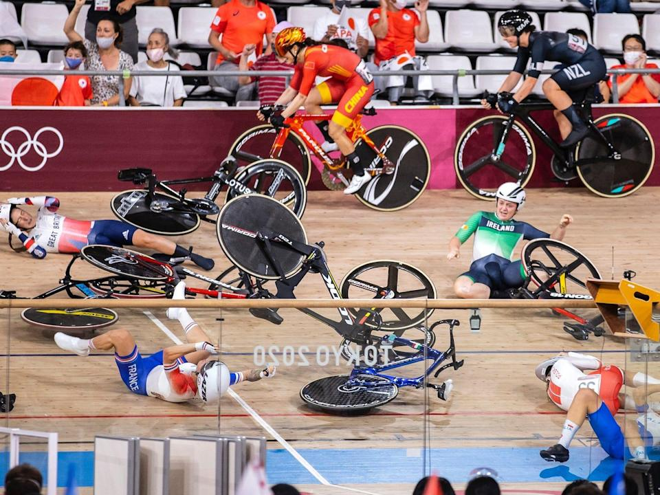 Riders are strewn on the track cycling course after a crash at the Tokyo Olympics.