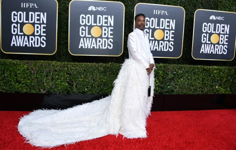 US actor Billy Porter won another Hollywood red carpet in a white tux with a giant feather train