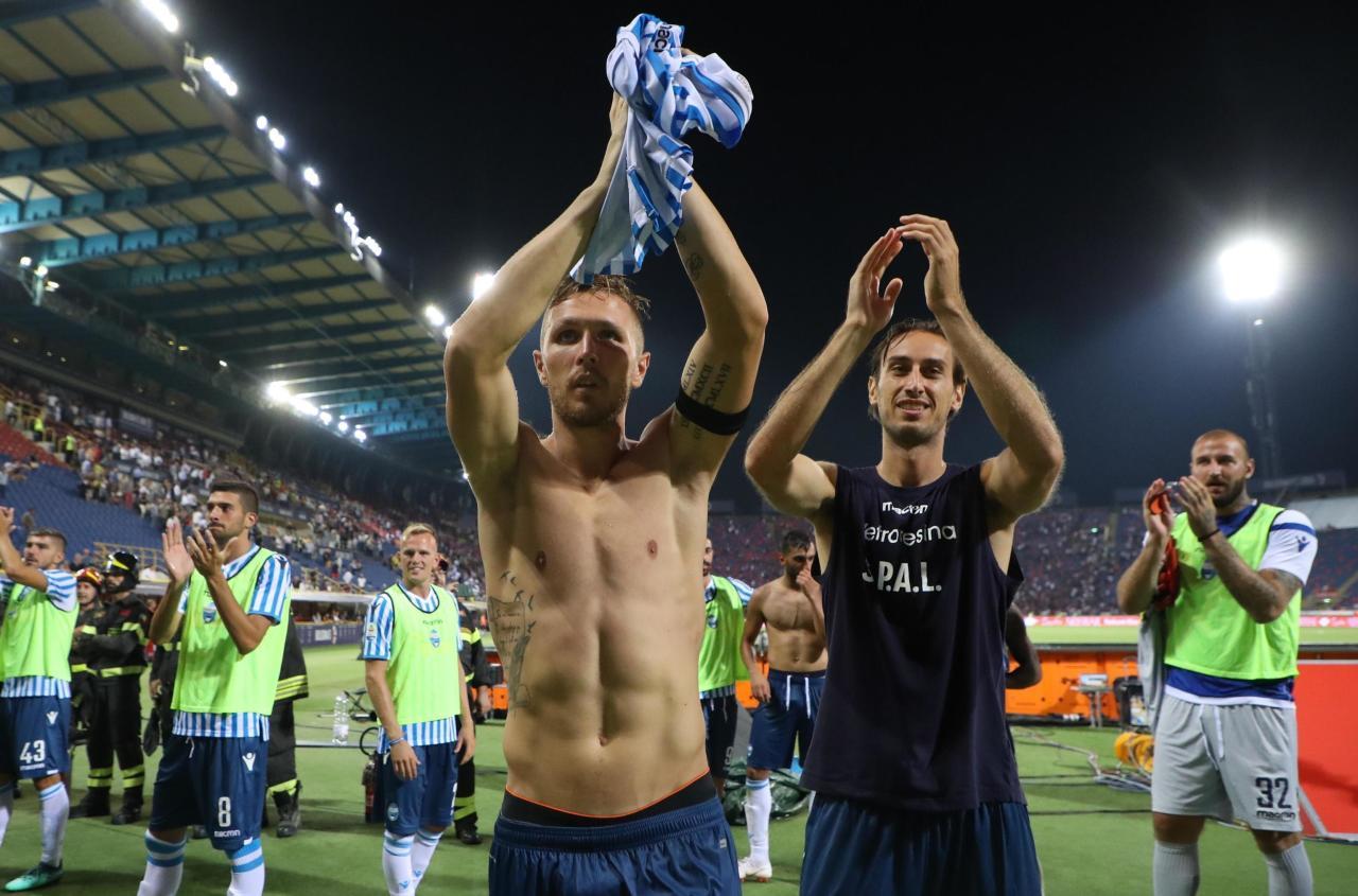 FILE - This Sunday, Aug. 19, 2018 file photo Spal's Jasmin Kurtic celebrates his side's 1-0 win at the end of the Serie A soccer match between Bologna and Spal, at the Dall'ara Stadium in Bologna, Italy. Through four rounds, the Ferrara-based team sits second in the standings, behind only seven-time defending champion Juventus and ahead of Napoli, last year's runner-up, on goal difference. (Giorgio Benvenuti/ANSA via AP, )