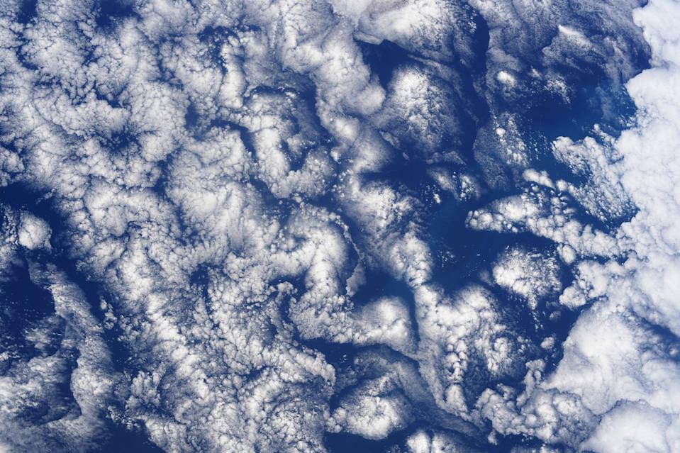 "Veteran NASA astronaut Doug Hurley, who launched to the International Space Station aboard SpaceX's Crew Dragon craft as part of the company's Demo-2 mission on May 30, snapped this incredible photo from the space station. Hurley's view from space shows striking cloud formations over the South Pacific Ocean. ""Cloud art in the South Pacific,"" Hurley wrote alongside the image which he shared on Twitter."