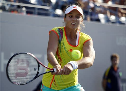 Laura Robson of Great Britain reaches for the ball against Kim Clijsters of Belgium in the second round of play at the 2012 US Open tennis tournament, Wednesday, Aug. 29, 2012, in New York. (AP Photo/Mel C. Evans)
