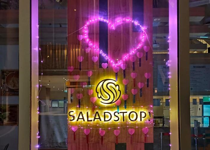 Pink lights and hearts in Salad Stop's storefront in support of Pink Dot 2021, Singapore's annual rally for LGBTQ equality. (Photo: Pink Dot)