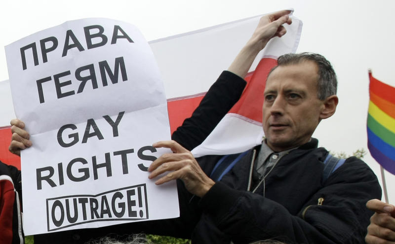 "British gay rights activist Peter Tatchell holds a a poster reading ""Gay Rights"" during a gay rights protest in Moscow, Russia, Saturday, May 16, 2009. Moscow police have violently dispersed a gay pride parade banned by the authorities. Riot police broke up a protest by around 20 gay pride activists, dragging them into detention buses. Activists called Russia's alleged homophobia ""a disgrace."" (AP Photo/Misha Japaridze)"