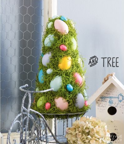 """<p>This easy-to-DIY tree is the perfect craft to do with the fam. All you need is a styrofoam cone, foam eggs, fake moss and voilà—a cute lil' Easter tree.</p><p><a href=""""https://www.thenavagepatch.com/cheerful-spring-wreath-and-tree/"""" target=""""_blank"""">Get the tutorial at The Navage Patch.</a></p>"""