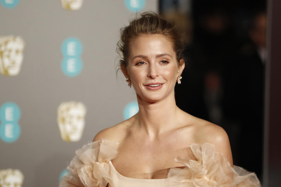 British actress Millie Mackintosh poses on the red carpet upon arrival at the BAFTA British Academy Film Awards at the Royal Albert Hall in London on February 10, 2019. (Photo by Tolga AKMEN / AFP) (Photo credit should read TOLGA AKMEN/AFP via Getty Images)