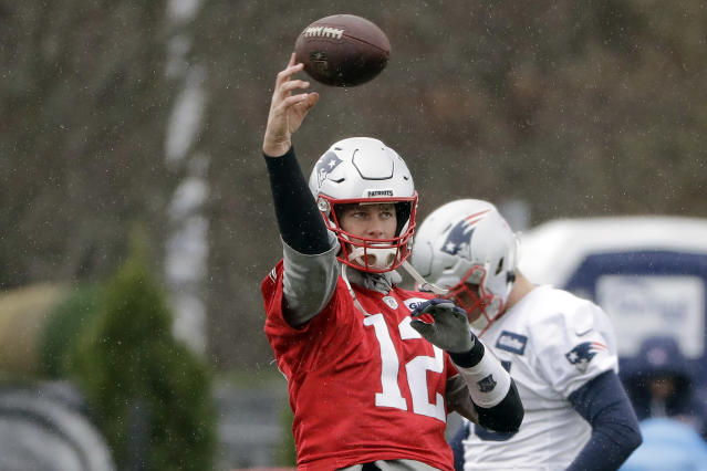 New England Patriots quarterback Tom Brady throws the ball while warming up during an NFL football practice, Wednesday, Nov. 20, 2019, in Foxborough, Mass. (AP Photo/Steven Senne)
