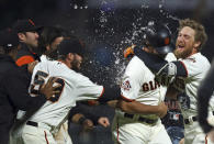 San Francisco Giants' Hunter Pence, right, celebrates with Madison Bumgarner, second from right, after Bumgarner made the game winning hit against the San Diego Padres in the 12th inning of a baseball game Tuesday, Sept. 25, 2018, in San Francisco. Giants won 5-4. (AP Photo/Ben Margot)