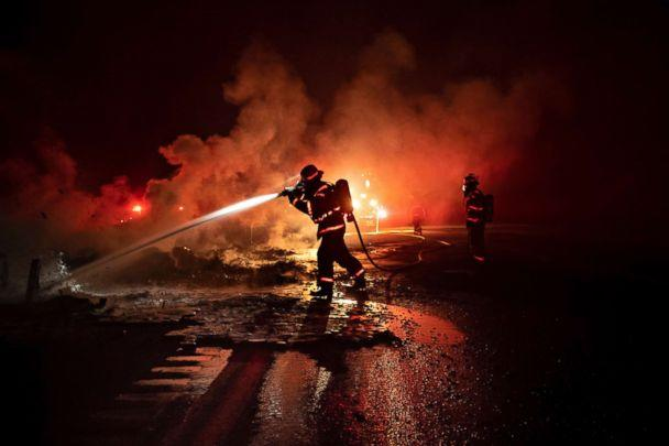 PHOTO: A firefighter sprays the smoldering remains of a vehicle on Interstate 5 as the Delta Fire burns in the Shasta-Trinity National Forest, Calif., on Wednesday, Sept. 5, 2018.  (Noah Berger/AP)