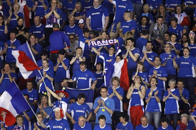 Supporters of France react during the single match between French tennis player Jo-Wifried Tsonga and German player Peter Gojowczyk, in the quarterfinals of the Davis Cup in Nancy, eastern France, Friday April 4, 2014.(AP Photo/Remy de la Mauviniere)