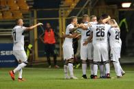 Parma's Roberto Inglese, center, celebrates with teammates after scoring during the Serie A soccer match between Parma and Udinese at the Ennio Tardini stadium in Parma, Italy, Sunday, Aug. 19, 2018. (Elisabetta Barcchi/ANSA via AP)