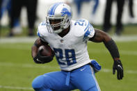 FILE - In this Dec. 20, 2020, file photo, Detroit Lions running back Adrian Peterson runs against the Tennessee Titans during the first half of an NFL football game in Nashville, Tenn. The fifth-leading rusher in NFL history is 36, but told SportsTalk 790 in Houston in July that he's still aiming to play at least another season. (AP Photo/Wade Payne, File)