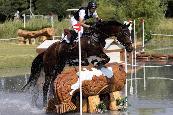 <p>India's Fouaad Mirza riding Seigneur competes in the equestrian's eventing team and individual cross country during the Tokyo 2020 Olympic Games at the Sea Forest Cross Country Course in Tokyo on August 1, 2021. (Photo by Yuki IWAMURA / AFP) (Photo by YUKI IWAMURA/AFP via Getty Images)</p>