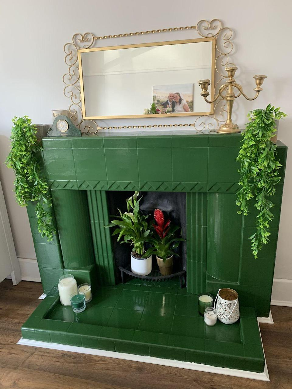 """<p>'Our drab old ceramic fireplace was looking very outdated, but money is tight so getting it knocked out would have cost too much. I therefore bought a tin of <a href=""""https://www.housebeautiful.com/uk/decorate/bathroom/a2255/bathroom-decorating-ideas-greenery/"""" rel=""""nofollow noopener"""" target=""""_blank"""" data-ylk=""""slk:green"""" class=""""link rapid-noclick-resp"""">green</a> paint - my favourite colour!'</p>"""