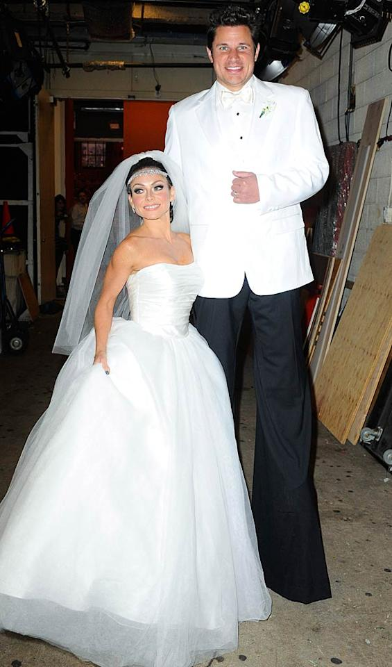 """Coincidentally, Kelly Ripa and her temporary morning show co-host Nick Lachey dressed as Kim and Kris in their wedding attire for the """"Live With Regis and Kelly"""" Halloween special on Monday, just hours before the divorce filings were announced. (10/31/2011)"""