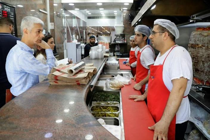 Lebanon's catering industry relies heavily on Syrian staff and Beirut restaurants are a major target of a government campaign against the employment of those without work permits (AFP Photo/JOSEPH EID)