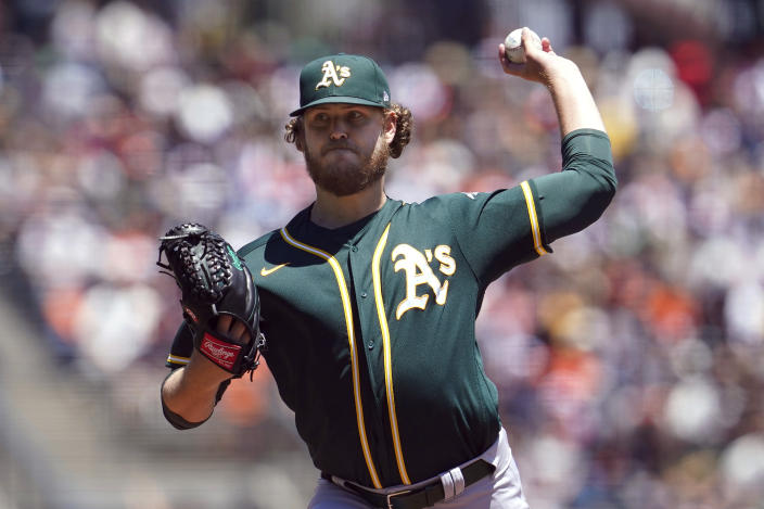 Oakland Athletics' Cole Irvin pitches against the San Francisco Giants during the first inning of a baseball game in San Francisco, Sunday, June 27, 2021. (AP Photo/Jeff Chiu)