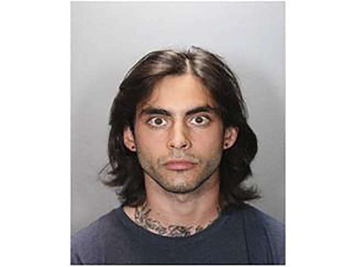 This undated photo provided by the Orange County District Attorney's Office shows Marcus Anthony Eriz, 24, was arrested in connection with a road rage shooting that killed a 6-year-old boy last month on a Southern California freeway. (Orange County District Attorney's Office via AP)