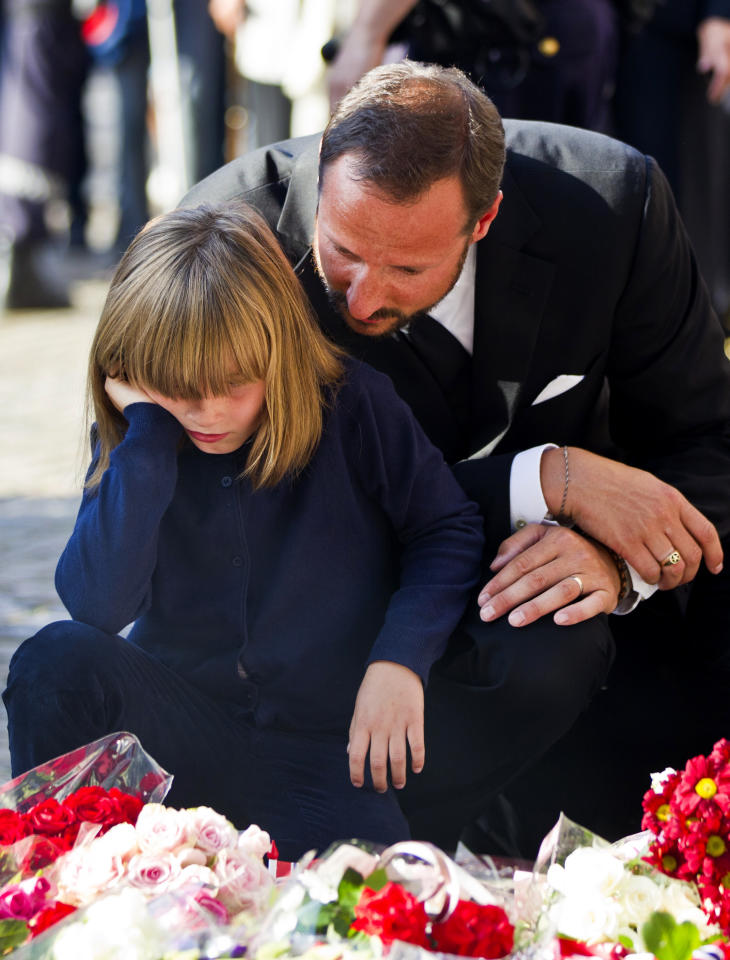Norwegian Crown Prince Haakon, right, and Princess Ingrid Alexandra attend a vigil for victims of Friday's attacks in Oslo and Utoya island, outside Oslo Cathedral, Saturday, July 23, 2011. A massive bombing Friday in the heart of Oslo was followed by a horrific shooting spree on an island hosting a youth retreat for the prime minister's center-left party. The same man, a Norwegian with reported Christian fundamentalist, anti-Muslim views, was suspected in both attacks. (AP Photo/Scanpix Norway, Vegard Groett) NORWAY OUT