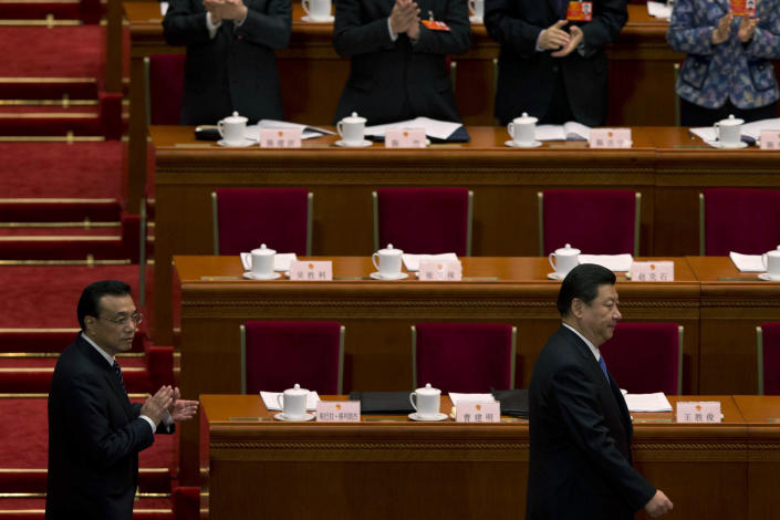 Chinese Communist Party General Secretary and incoming-President Xi Jinping, right, walks ahead of Chinese premier-in-waiting, Li Keqiang during a plenary session of the National People's Congress at the Great Hall of the People in Beijing, China, Sunday, March 10, 2013. China announced plans Sunday to streamline government ministries, doing away with the powerful Railways Ministry and creating a super-agency to regulate the media and realigning other bureaucracies in a bid to boost efficiency. (AP Photo/Ng Han Guan)