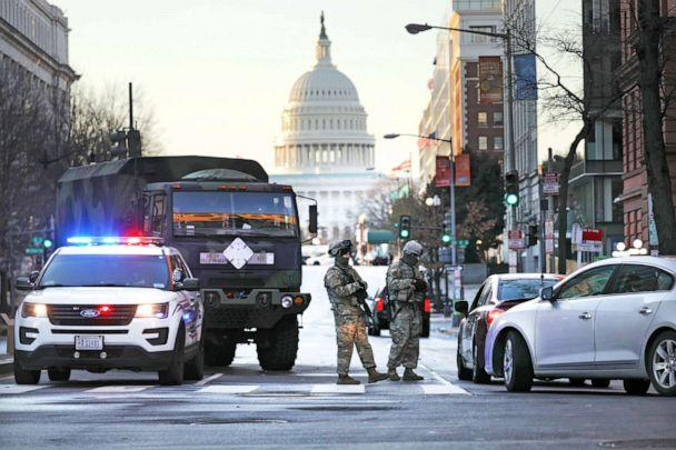 PHOTO: Members of the National Guard patrol a street leading to the U.S. Capitol ahead of the inauguration of U.S. President-elect Joe Biden on Jan. 20, 2021 in Washington, D.C. Law enforcement and state officials are on high alert. (Spencer Platt/Getty Images)
