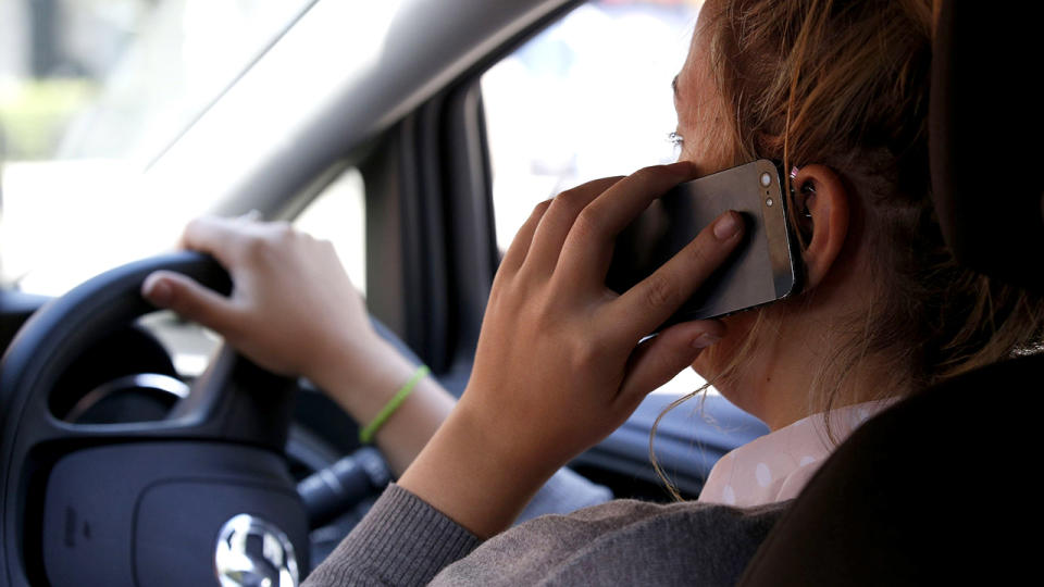 Queensland drivers using mobile phones while driving could soon be fined $1000 in proposed new laws.