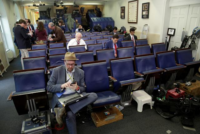 Glenn Thrush works in the briefing room after being excluded from a gaggle at the White House on Feb. 24.