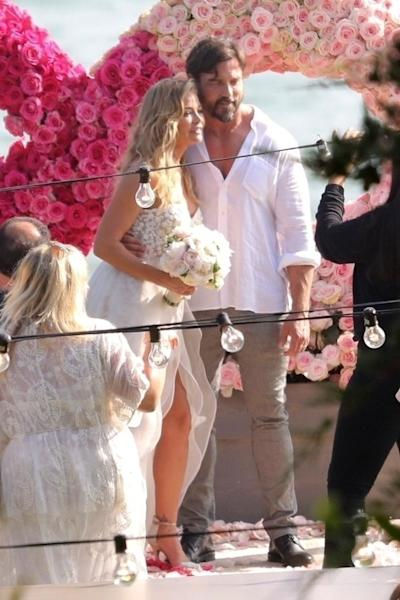 The intimate ceremony was captured by 'Real Housewives of Beverly Hills' cameras, a source tells ET.