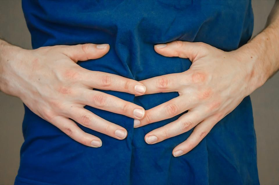 A man holding his stomach.