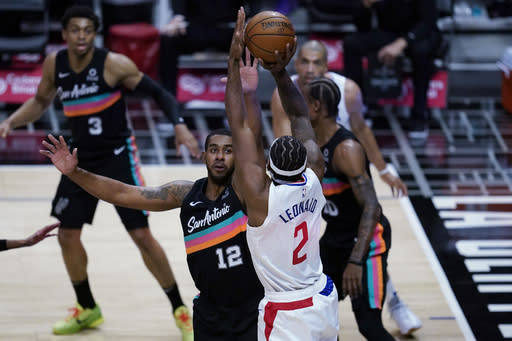 San Antonio Spurs forward LaMarcus Aldridge, front left, defends against Los Angeles Clippers forward Kawhi Leonard during the first quarter of an NBA basketball game Tuesday, Jan. 5, 2021, in Los Angeles. (AP Photo/Ashley Landis)