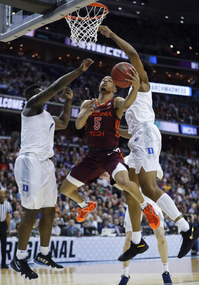<p>Virginia Tech guard Justin Robinson (5) drives to the basket around Duke forward Zion Williamson (1) and center Marques Bolden (20) during the second half of an NCAA men's East Regional semifinal college basketball game in Washington, Friday, March 29, 2019. (AP Photo/Patrick Semansky) </p>