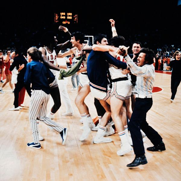 US basketballers mistakenly celebrate what they thought was victory over the Soviet Union in the 1972 Olympics, before the USSR won by one point (AFP Photo/-)