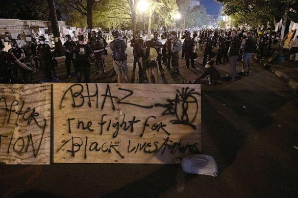 PHOTO: Protesters confront police near a barricade they erected and marked with the sign 'Black House Autonomous Zone' in front of Lafayette Park near the White House, June 22, 2020. (Roberto Schmidt/AFP via Getty Images)