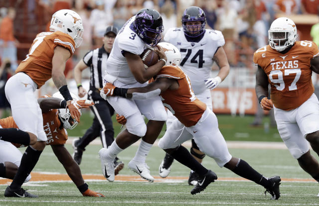 TCU quarterback Shawn Robinson (3) is hit by Texas defensive back Chris Brown (15) on a keeper run during the first half of an NCAA college football game, Saturday, Sept. 22, 2018, in Austin, Texas. (AP Photo/Eric Gay)