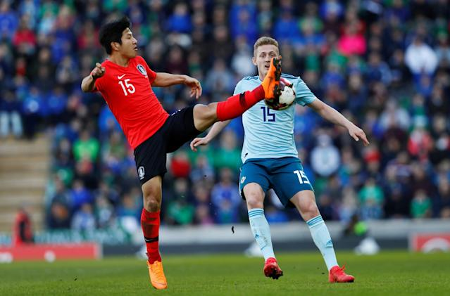 Soccer Football - International Friendly - Northern Ireland vs South Korea - National Football Stadium at Windsor Park, Belfast, Britain - March 24, 2018 South Korea's Park Joo-Ho in action with Northern Ireland's George Saville Action Images via Reuters/Jason Cairnduff