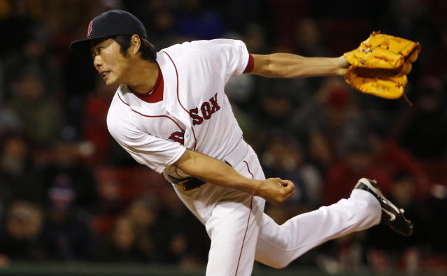 Boston Red Sox relief pitcher Koji Uehara, of Japan, delivers against the Milwaukee Brewers during the ninth inning of a baseball game at Fenway Park in Boston, Saturday, April 5, 2014. (AP Photo/Winslow Townson)