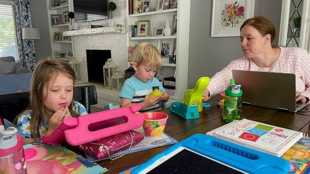 PHOTO: Kate Dando Doran, of Colorado, works at her dining table alongside her two children, ages 5 and 3. (Kate Dando Doran)