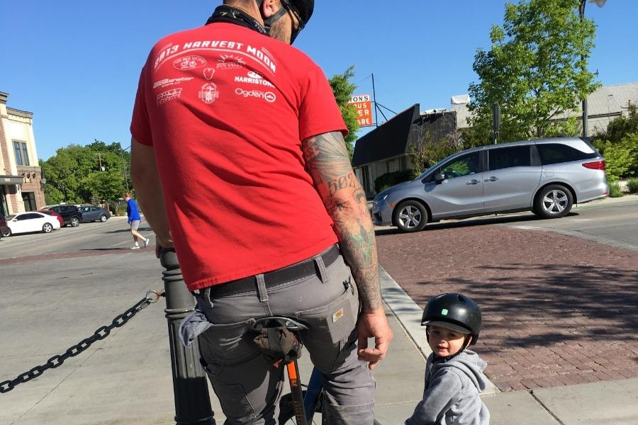 Todd is seen riding his bike next to his young son, who is also on his own bike. Source: GoFundMe