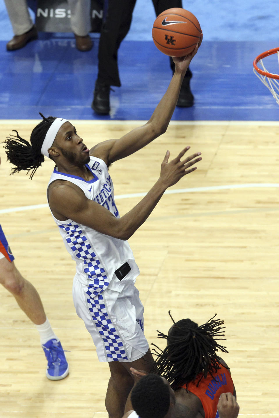Kentucky's Isaiah Jackson, top, shoots near Florida's Anthony Duruji during the second half of an NCAA college basketball game in Lexington, Ky., Saturday, Feb. 27, 2021. (AP Photo/James Crisp)