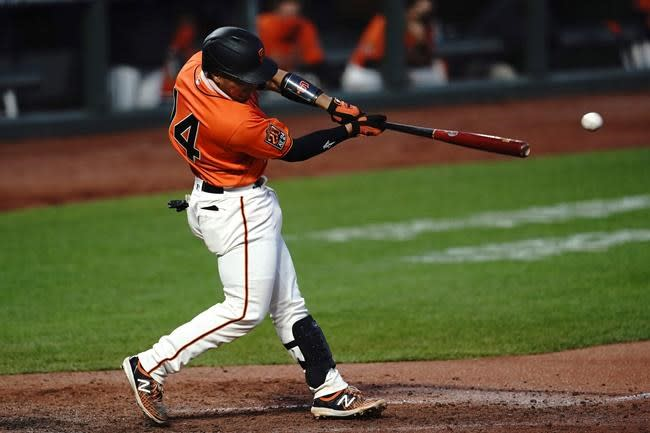 Flores homers to get Giants going in 9-2 win over Rangers