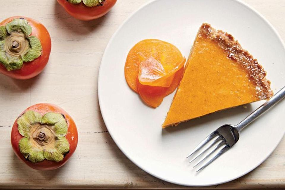 """<p>And here's a fruity twist on the classic: This one adds the floral flavor of fresh persimmons to the pumpkin, while the crust is brushed with apricot preserves. <a href=""""https://www.yahoo.com/food/persimmon-pumpkin-pie-from-happy-cooking-194605116.html"""" data-ylk=""""slk:Learn how to make Persimmon-Pumpkin Pie here.;outcm:mb_qualified_link;_E:mb_qualified_link;ct:story;"""" class=""""link rapid-noclick-resp yahoo-link""""><b>Learn how to make Persimmon-Pumpkin Pie here</b>.</a> (<i>Photo: Megan Fawn Schlow)</i><br></p>"""
