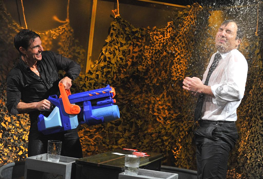 "NEW YORK, NY - DECEMBER 18:  Tom Cruise and Jimmy Fallon play a game of ""Water War"" during a taping of ""Late Night With Jimmy Fallon"" at Rockefeller Center on December 18, 2012 in New York City.  (Photo by Theo Wargo/Getty Images)"