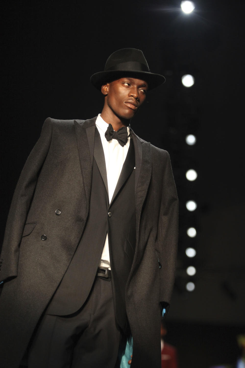 A model displays an outfit by designer Ozwald Boateng of the United Kingdom at the ARISE Fashion Week event in Lagos, Nigeria on Sunday, March 11, 2012. (AP Photos/Sunday Alamba)