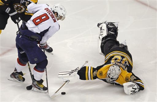 Boston Bruins goalie Tim Thomas (30) dives to make a save on a shot by Washington Capitals left wing Alex Ovechkin (8) during the second period of Game 7 of an NHL hockey Stanley Cup first-round playoff series, in Boston on Wednesday, April 25, 2012. (AP Photo/Charles Krupa)